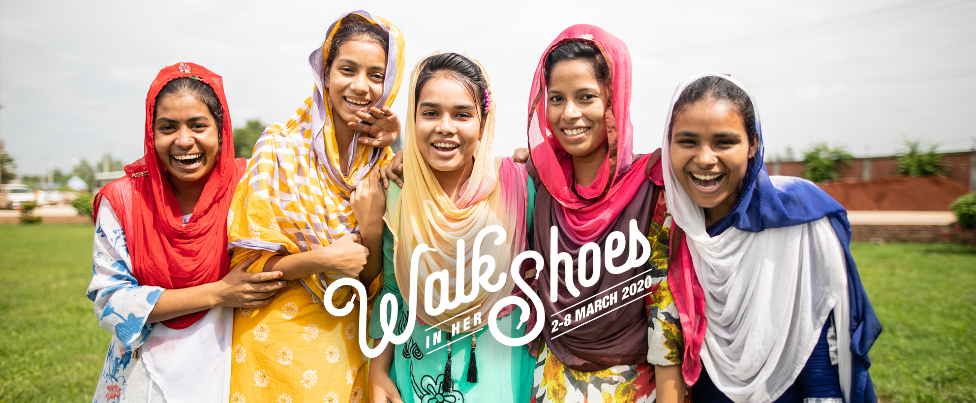 Walk in her Shoes logo over image of five girls smiling.