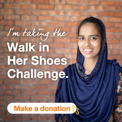 Smiling girl with brick wall in the background and text that says I'm taking the Walk In Her Shoes challenge. A button says Make a donation