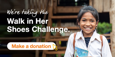 A smiling school girl with steps in the background. The text says We're taking the Walk In Her Shoes challenge. A button says Make a donation.