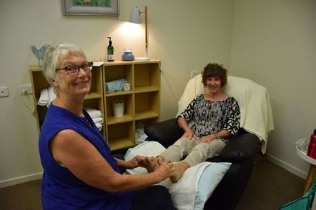 Small sue recieveing reflexology with therapist kathy v2