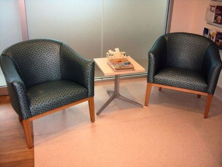 Small armchairs in patient waiting area